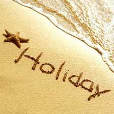 holidays written in sand